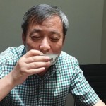 Mr. Liu drinks from his rare $36 million cup. (Sotheby's)